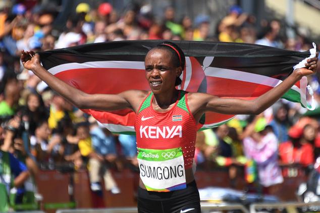 Kenya's Jemima Jelagat Sumgong celebrates winning the women's marathon during the Summer Olympics athletics event in Rio de Janeiro, Brazil, Sunday, Aug. 14, 2016.   (Johannes Eisele/Pool Photo via AP)