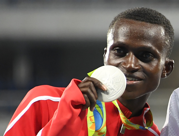 Kenya's Paul Kipngetich Tanui poses with his silver medal on the podium of the Men's 10,000m during the athletics event at the Rio 2016 Olympic Games at the Olympic Stadium in Rio de Janeiro on August 13, 2016.   / AFP / Damien MEYER        (Photo credit should read DAMIEN MEYER/AFP/Getty Images)